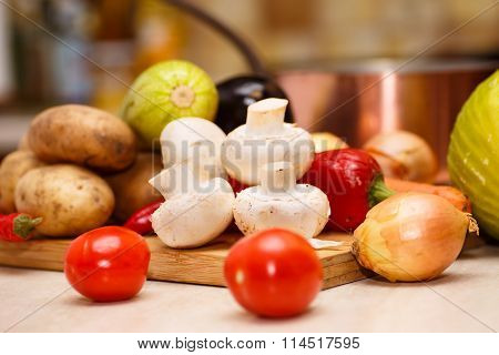 Raw vegetables for stew on the black Board