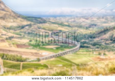 Defocused Background With A S-curve Highway Overpass In Sicily, Italy