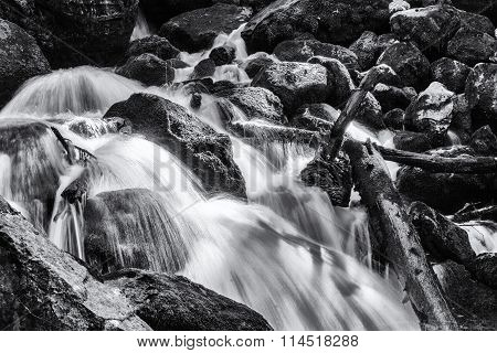 Rushing water at The Eyes of the Devil or Eyes of Jupiter waterfall moving through rocks in Spain during the summer