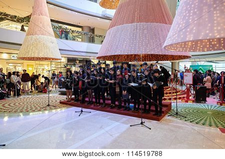 HONG KONG - DECEMBER 25, 2015: choir at ifc shopping mall in Hong Kong. Hong Kong shopping malls are some of the biggest and most impressive in the world