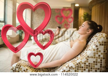 Couple relaxing in the thermal suite against pink hearts