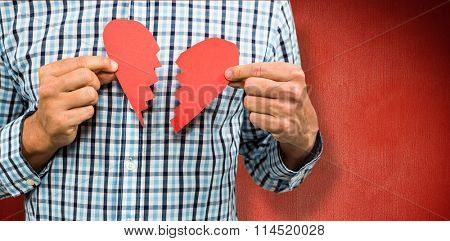 Sad man with broken heart against red background