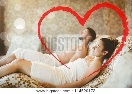 Man and woman lying down together against heart