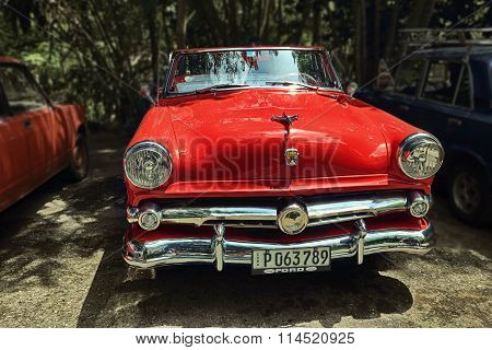 CUBA, HAVANA-JUNE 26, 2015: Classic red Ford on a street in Havana.