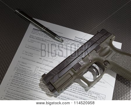 Handgun And Paperwork