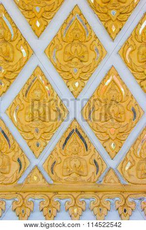 wall texture at Wat Phrathat Hariphunchai temple Lamphun province Thailand