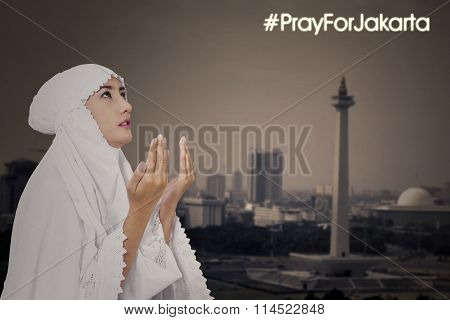 Female Muslim Praying For Jakarta