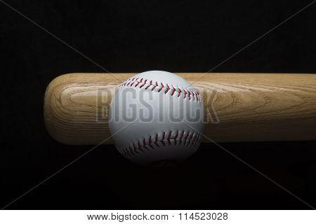 Baseball with baseball bat