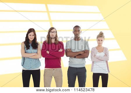 Portrait of business team with arms crossed while standing in a row against yellow vignette