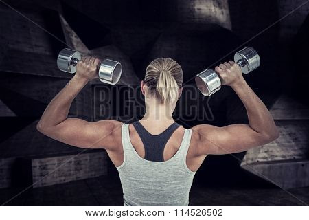 Muscular woman working out with dumbbells against black angular design Muscular woman working out with dumbbells on white background