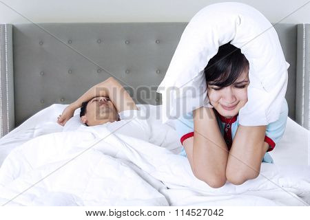 Snoring Man And Unhappy Woman