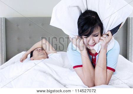 Snoring Man And Wife On Bed