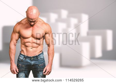 Muscular sad man looking down against abstract background