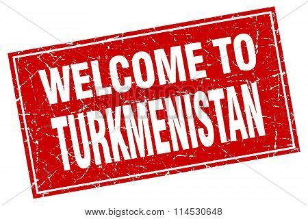 Turkmenistan red square grunge welcome to stamp