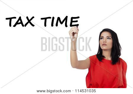 Woman Writes Tax Time On Whiteboard