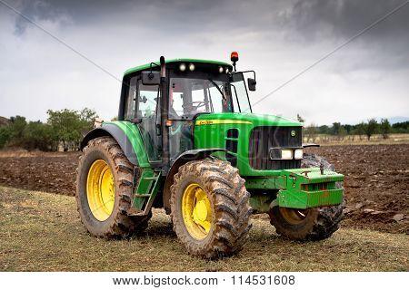 Karlovo, Bulgaria - August 22Th, 2015: Ploughing A Field With John Deere 6930 Tractor. John Deere 81
