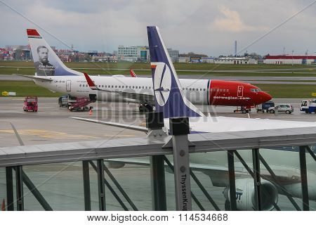 Preflight Service Of The Norwegian And Polish Airlines Planes In Warsaw Chopin Airport, Poland