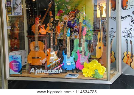 Different Types Of Guitars In The Window Of The Shop Of Musical Instruments In Haarlem, The Netherla