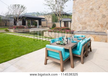 elegant furniture in the patio outside building