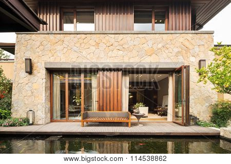 design and furniture of entrance near fishpond