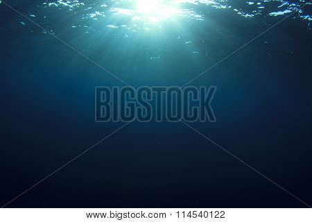 Underwater blue ocean background and sun