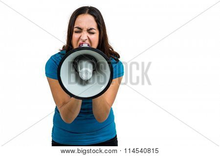 Angry woman shouting through megaphone on white background