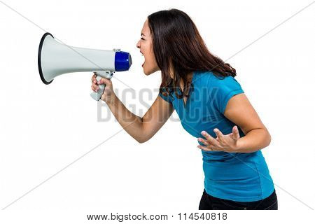 Woman shouting while holding megaphone on white background