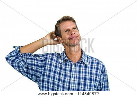 Thinking businessman scratching his head against white background