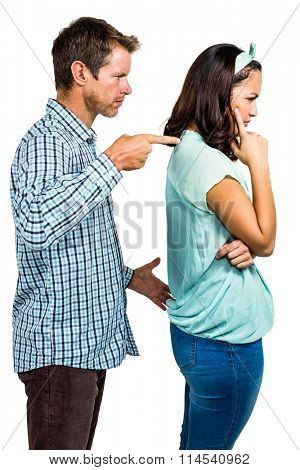 Angry boyfriend shouting at girlfriend on white background