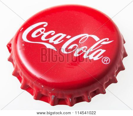 Used Red Cap From The Glass Bottle Of Coca-cola
