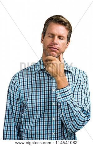 Close-up of thoughtful man with eyes closed against white background
