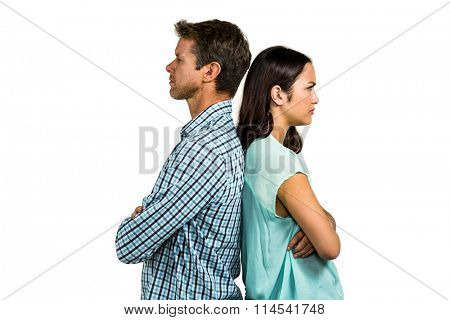 Angry couple standing back to back against white background