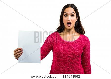 Portrait of worried woman holding document on white background