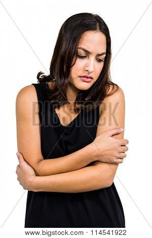 Upset beautiful woman standing against white background
