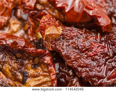 Dried Red Tomatoes In Olive Oil Close Up