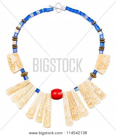 Necklace From Carved Bone And Blue Glass Beads