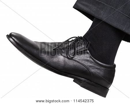 Male Left Leg In Black Shoe Takes A Step