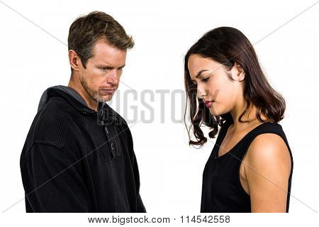 Irritated couple not talking after argument on white background