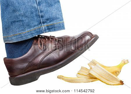 Right Leg In Jeans And Shoe Slips On Banana Peel