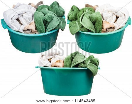 Set Of Round Green Plastic Washbasins With Towels