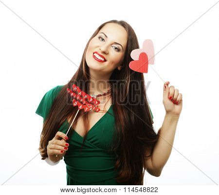 beautiful woman wearing green dress holding paper hearts