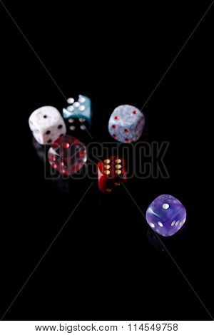 Several Color Dices On Black Board