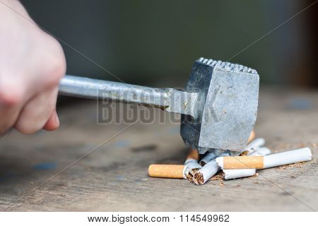 Human hands breaking the cigarettes