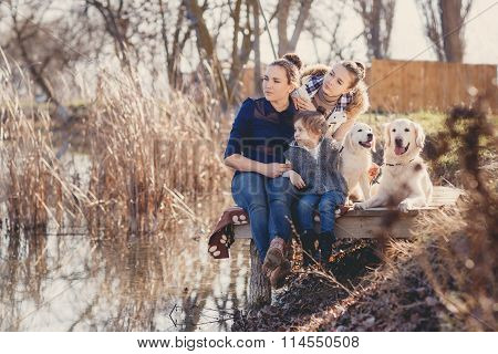 Happy family with Pets near the lake