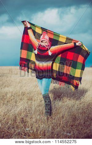 Nomadic woman holding blanket, enjoy freedom outdoor