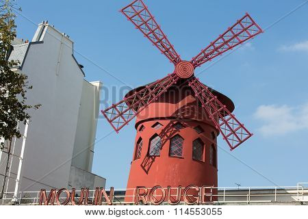 PARIS , FRANCE -SEPTEMBER 10,  2014: The Moulin Rouge in Paris France. Moulin Rouge is the most famous Parisian cabaret and it created the modern can-can dance.