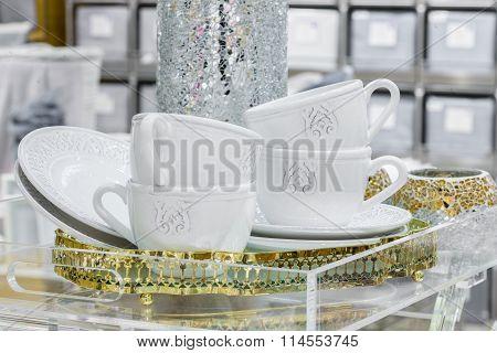 white dishware and shiny vase