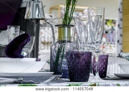 plants in vase and shiny glasses