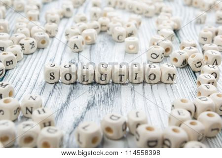 Solution word written on wood block.