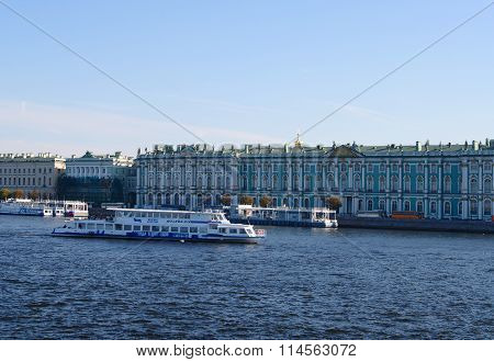 St.Petersburg, Russia - October 7, 2014:  pleasure boat on Neva river at Dvortcovaya embankment